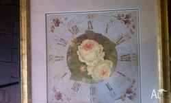 This is a very pretty print of a clock with cream roses