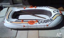 Inflatable vinyl boat for beach or pool. For 1 adult or