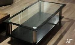 I have a glass coffee table for sale. Fair condition.