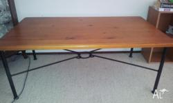 Coffee table with wrought iron legs and pine table
