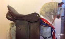 Brown collegiate dressage saddle, easy change gullet