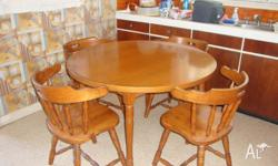 Colonial timber table and 4 captain chairs (1 needs