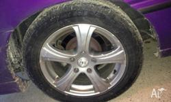 16inch commodore mags, 2 near new tyres, 2 about