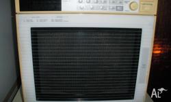 Mitsubishi Cube Microwave complete with manual and