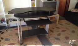 Computer table in good condition. Very flixible and