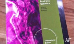Contemporary Business Statistics textbook in excellent