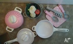 Toy cooking pots, pan, drainer with play food of
