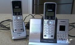 2 cordless phones. Uniden main base has speaker phone