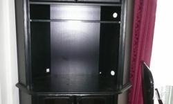 Black corner TV/Entertainment unit on castors in good
