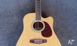 For sale is a Cort MR710F acoustic guitar with hard