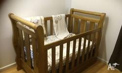 Cot, Bedding, Change Table and baby bath for sale. All