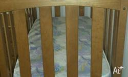 wooden cot and change table for sale. Has been stored