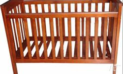 Brown Wooden Cot in pretty good condition. Converts