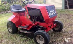 "Cox mower 11.5 HP, 28"" cut, 1998 model, one owner and"