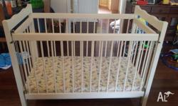 Cream handpainted cot for sale. Drop down side. 136cm