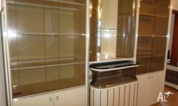 In Good Condition wall unit with glass with gold