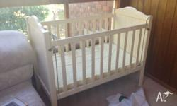 Cream wooden cot with brand new mattress not used. $50