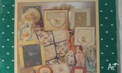 "On offer is a cross-stitch pattern book titled ""Nursery"