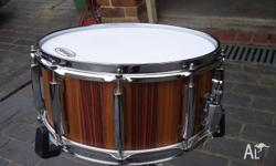 custom handmade Stave shell snaredrums , finished in a