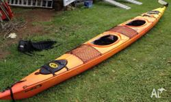 DAG Biwok double sea kayak with paddles and life vests.
