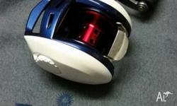 Daiwa Advantage HD with geneo kustoms paint job. 9.5/10