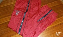 Red Size Large suit 30-38 inch waist Shell: 100% Nylon