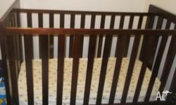 Dark wood cot with matress. Barely used. Has a few