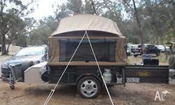 Deluxe on road camper trailer made by Customline. It