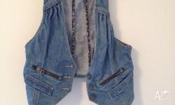 Denim vest from pull and bear. Floral interior lining