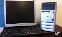Desktop computer with 17 inch screen and mouse. Windows