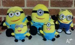 Lot of plush Minions as pictured. 2 lg, 2 sm, 1 med toy