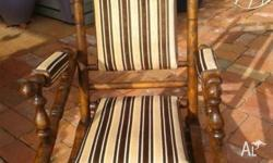 Meticulously restored DEXTER rocking chair. Has been