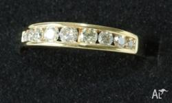 18ct Gold Channel Set Diamond Ring. Total 9 Diamonds
