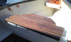Fibreglass dinghy with timber trim. Complete with