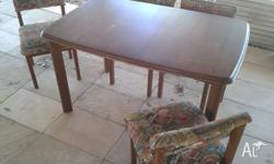 Dining room table and four chairs wooden. 820 wide x