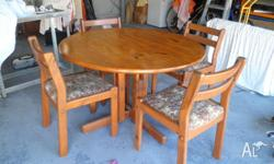 Pine dining table and 4 chairs. Table top has been
