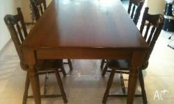 A lovely 6 peice brown dining table. The table has been