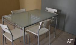 Dining glass table and 4 chairs, white, silver-colour.