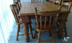 1 dining table pine 1.800 x 1100 and 8 pine chairs.