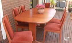 Extendable dining table and six chairs
