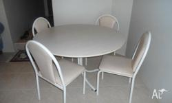 dining table with 4 chairs round and creamy colour,