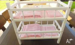 White wooden doll bunk beds. They come apart so you can