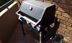 Double BBQ with grill and hot plate. Gas bottle