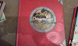 dragonology book $15. plus or books are 5 bucks each