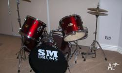 7 Piece Drum Kit plus stool. Hardly used and in