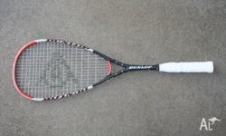 Dunlop graphite squash racquet. In good condition.