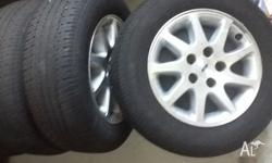 Ea-el falcon alloy rims with good tyres 205/65/15 Ea eb