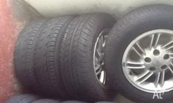 Ea-EL rims set of 4 with good tyres 205/65/15 Ea eb ed