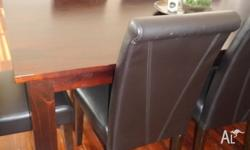 Large dark timber dining table, with eight dark leather