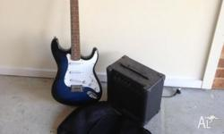 Electric guitar with amp and guitar bag. Missing the